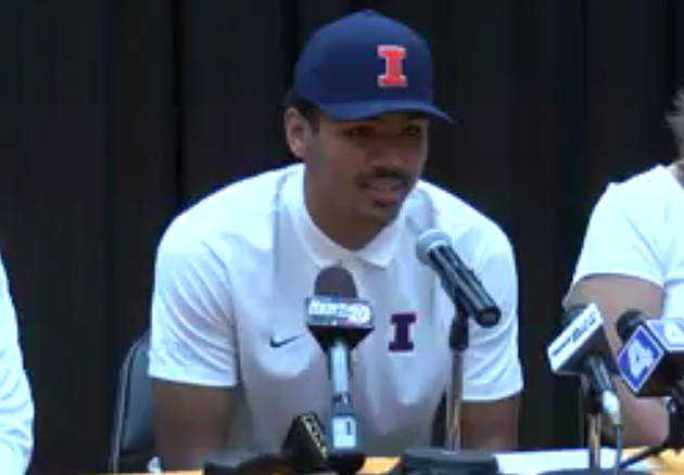 Mark Smith dons an Illinois hat and shirt as he makes his commitment official Wednesday night. (Screenshot courtesy IllinoisHomePage.net)